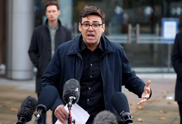 Manchester mayor Andy Burnham  giving a press conference.