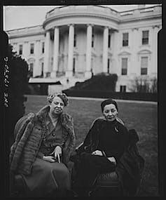 Two women sitting outside.