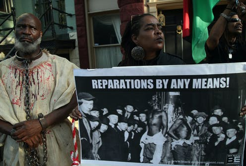 Activists stage a protest.