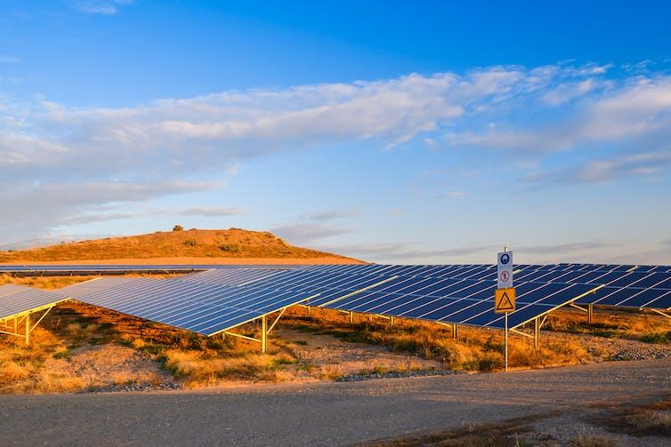 Solar farm in the desert at sunset