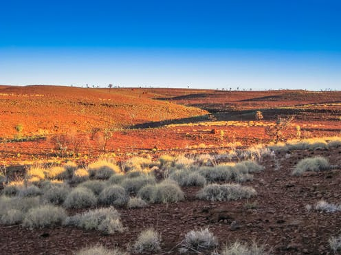 A vast expanse of the West Australian outback in the sun.