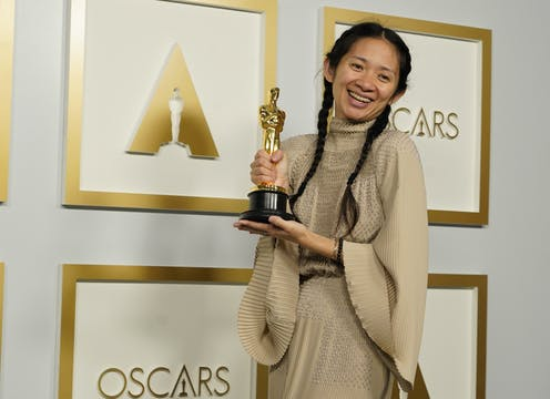 woman with oscar award