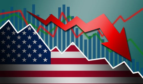 A U.S. flag with a bar chart and red arrow behind it, plunging downward.