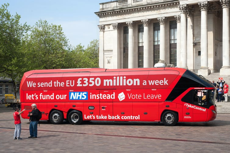 A single-decker red London bus with the slogan: 'We send the EU £350 million a week. Let's fund the NHS instead. Vote Leave'