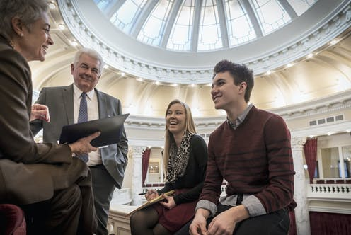 Two interns talk to two politicians in Capitol Hill.