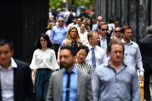 Office workers walking along crowded Sydney street.