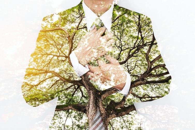 Composite image of man in business suit and tree branches