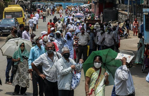 Residents of Mumbai line up for a vaccine.