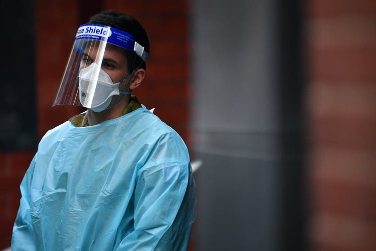 A hotel quarantine worker wearing PPE.