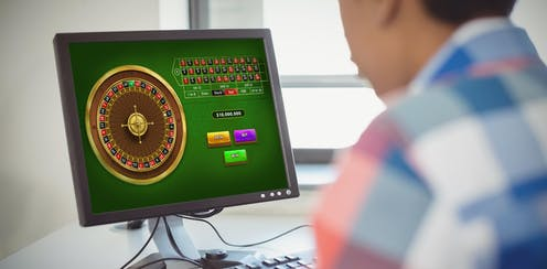Young person in check shirt gambling online