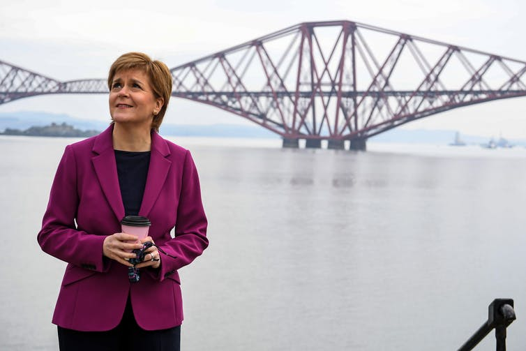 Nicola Sturgeon next to the Forth Bridge