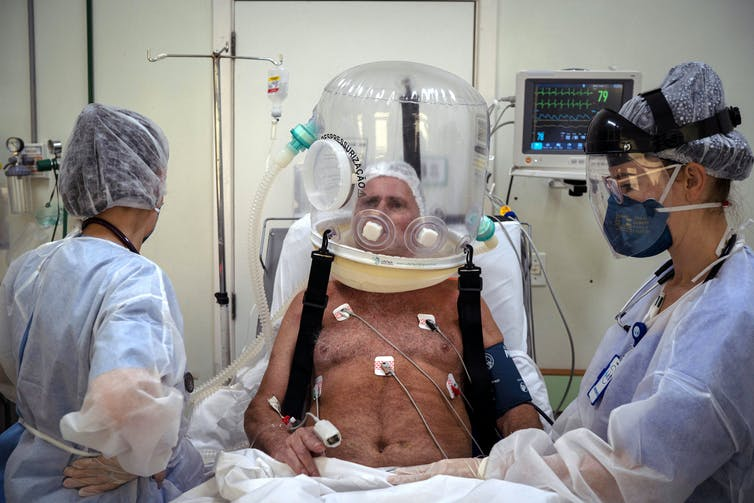 A Brazilian man in hospital being treated for COVID-19.