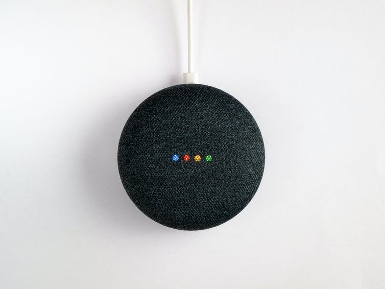 A Google Home speaker photographed from above.