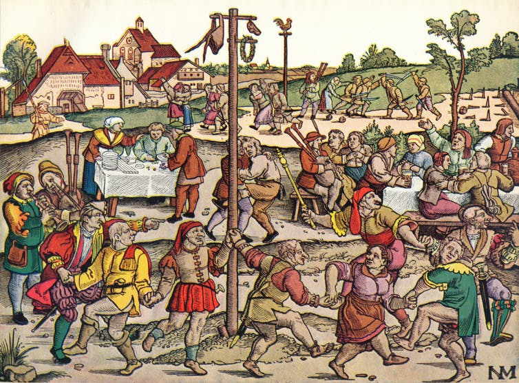 Revelers dance around a maypole in Germany in the 16th century.