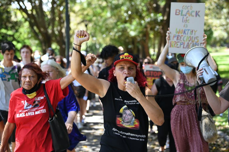 Protestors march during a Black Lives Matter rally in Sydney, Monday, December 7, 2020