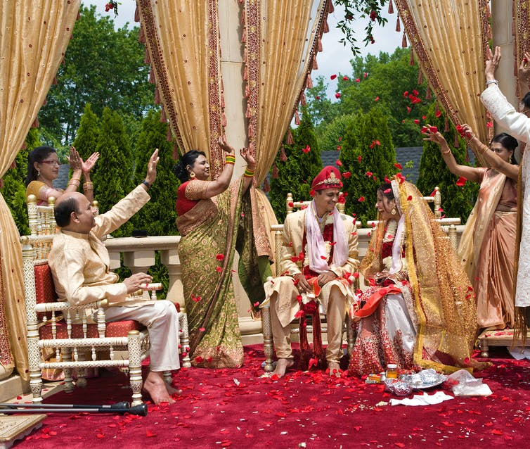 Family celebrates during Indian outdoor wedding