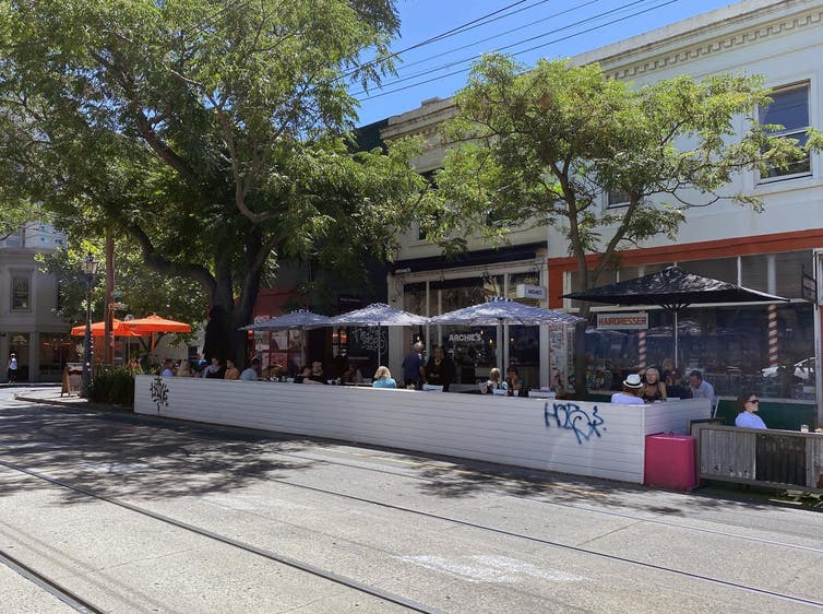 a streetside parklet set up for outdoor dining