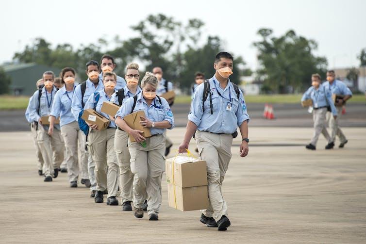 AUSMAT team departing for PNG.