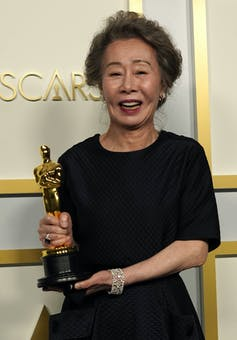 Youn Yuh-jung poses in the press room at the Oscars.