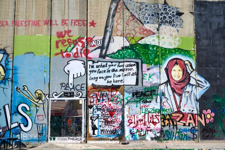 The West Bank separation wall in Bethlehem, covered in murals and graffiti.