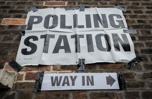 A sign for a polling station.