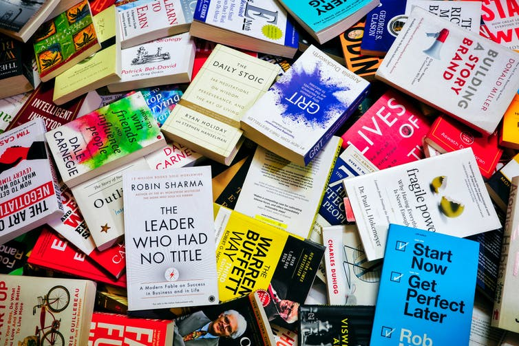 A messy pile of self-help books.