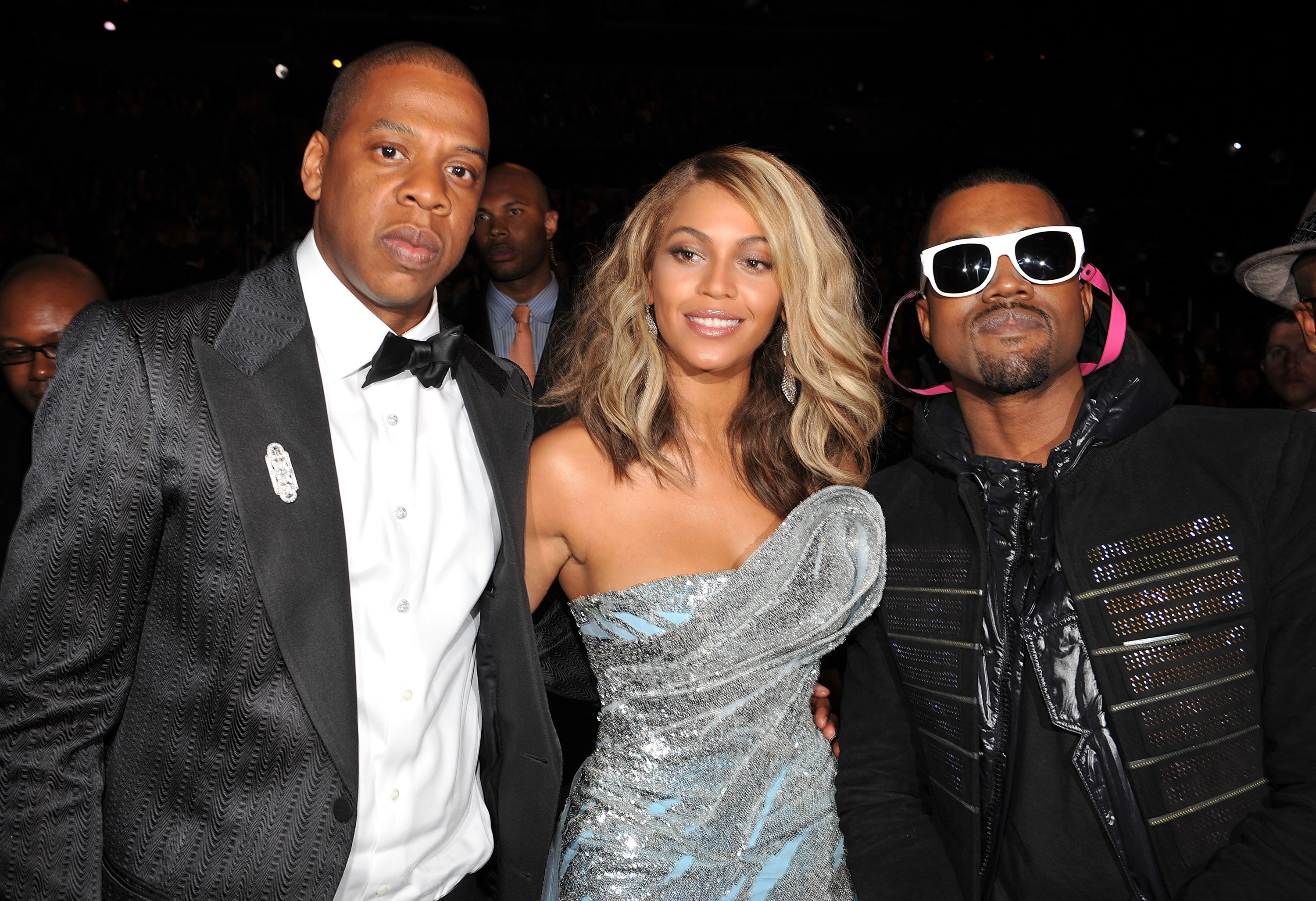 Three celebrities attend an event.