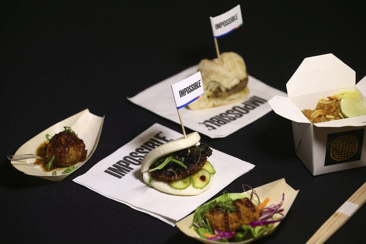 Food dishes on a table with the words 'impossible' around them.