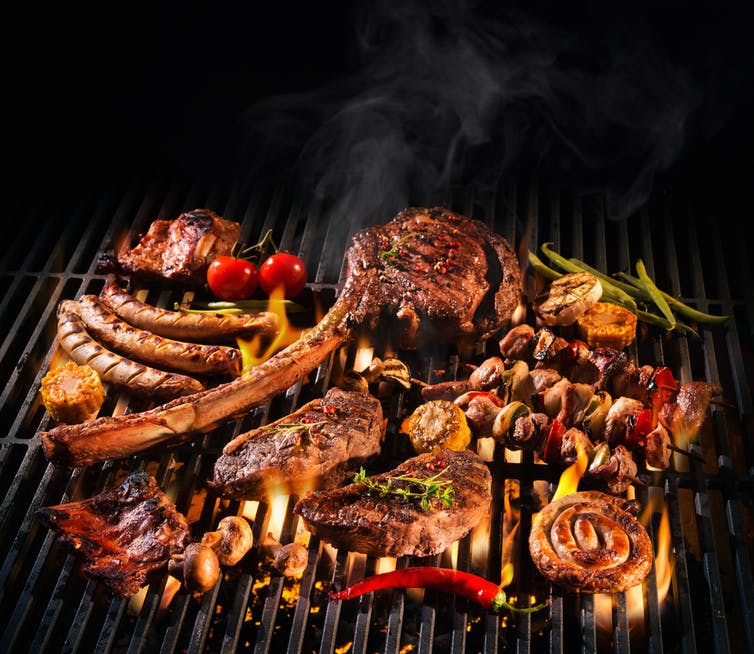 A variety of meats on a barbecue grill