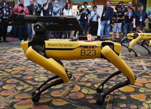 Boston Dynamics robot dog with people looking at it