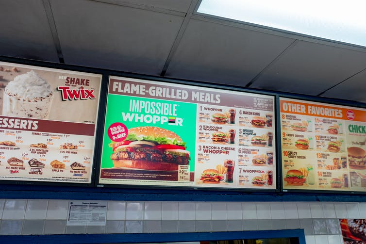 Close-up of Burger King menu board with advertisement for the Impossible Whopper