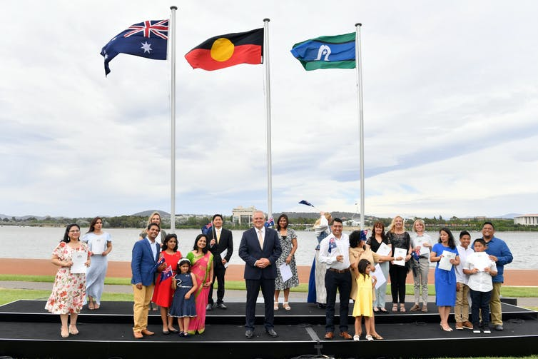 Prime Minister Scott Morrison with new citizens at an Australia Day ceremony in Canberra.