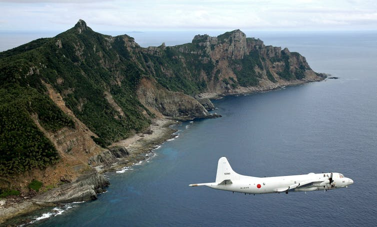 Japanese plane flies over Senkaku Islands.