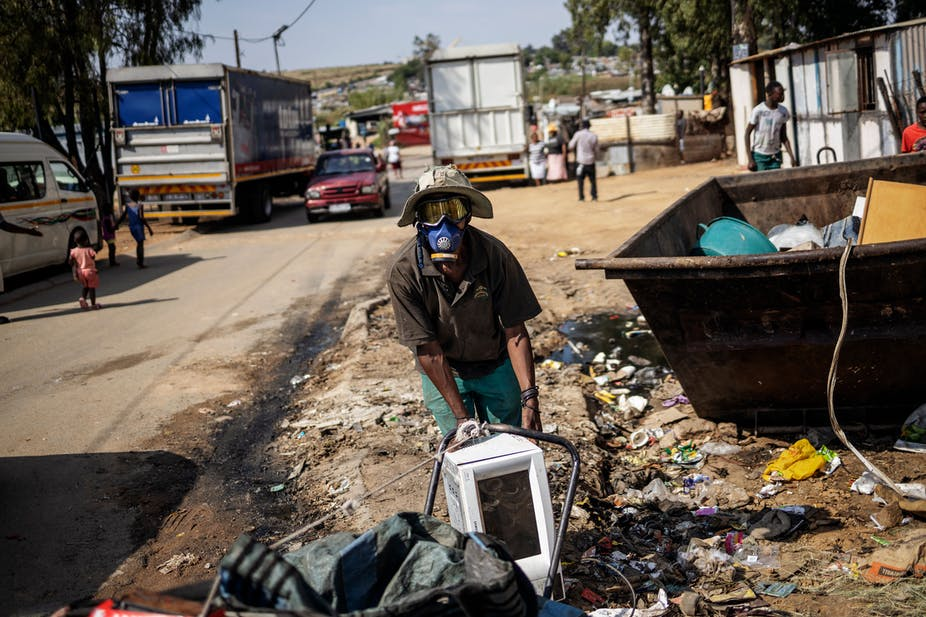Waste reclaimer picking up waste.