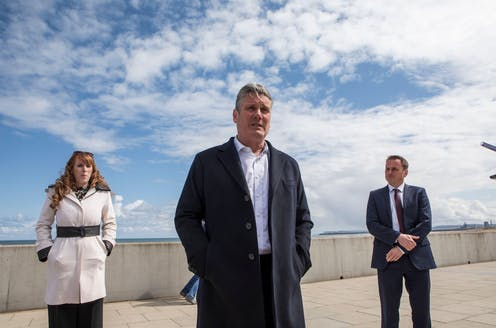Angela Rainer, Keir Starmer and Paul Williams standing on the sea front.