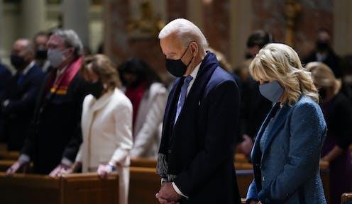 Joe Biden and his wife Jill Biden attending mass in church.