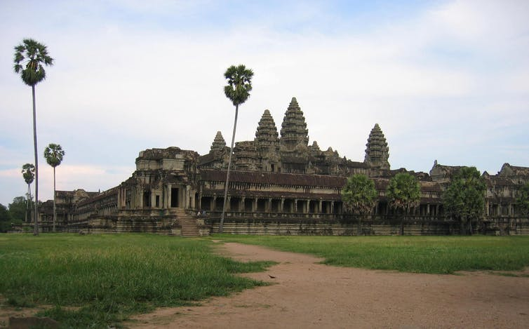Angkor Wat temple with palm trees