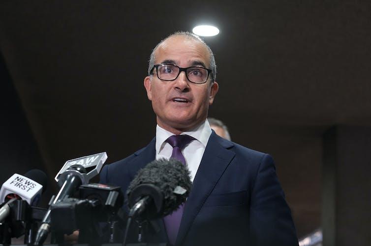James Merlino delivering a press conference