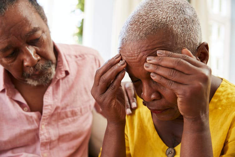 A concerned older man and a distraught older woman