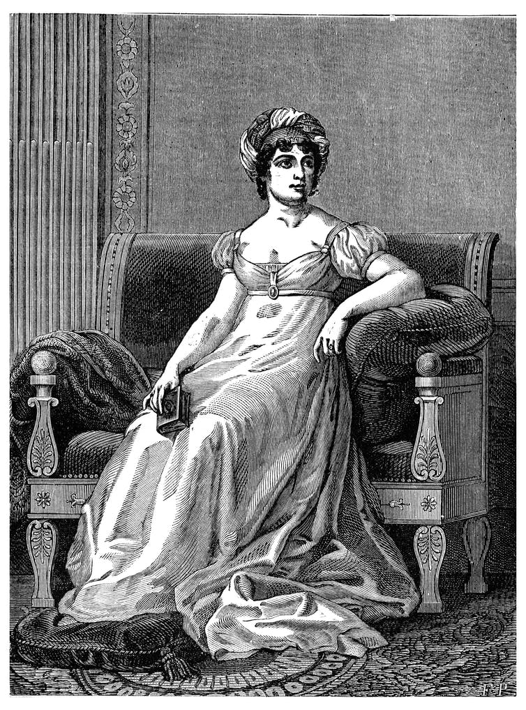 Black and white illustration of Germaine de Staël in a dress sitting on a large chair