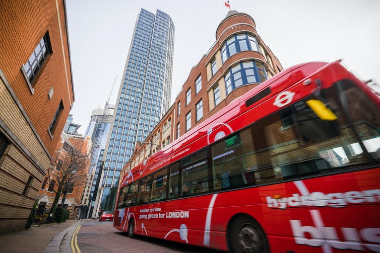 A red bus on a central London street
