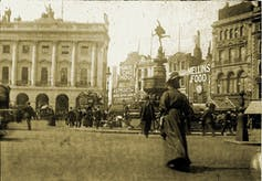 Woman standing at Piccadilly Circus, London.
