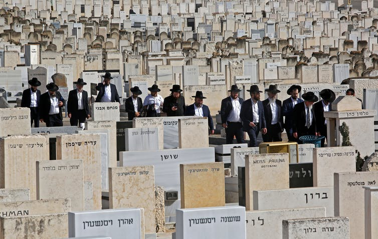 Ultra-Orthodox Jews attend a funeral at Segula cemetery in Petah Tikva on April 30, 2021, for one of the victims of the Meron stampede.