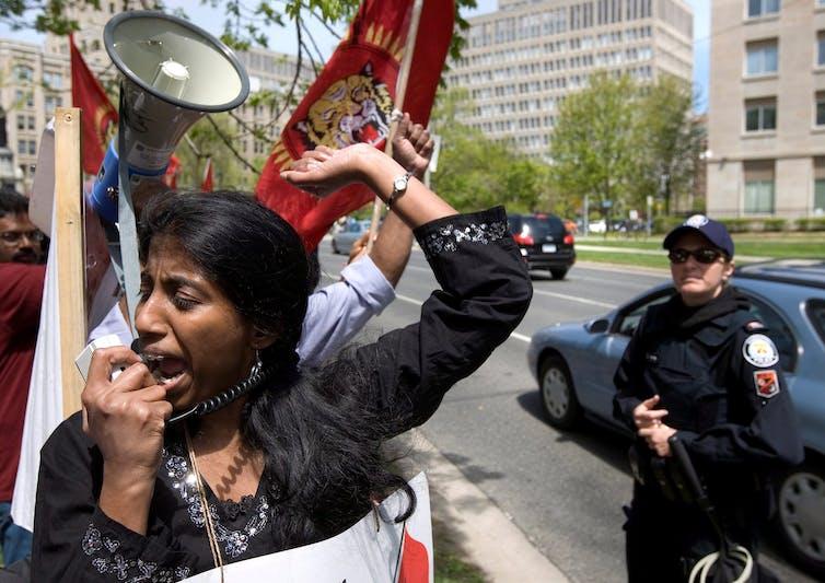 Woman shouts into megaphone