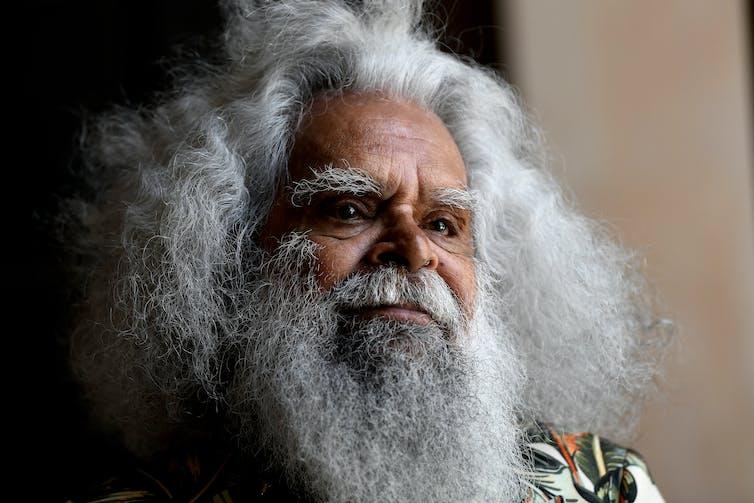 Indigenous man with bushy beard.