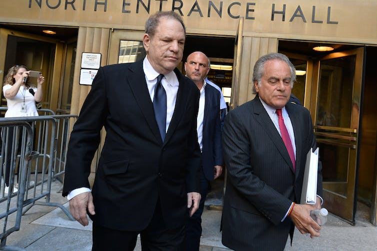 Harvey Weinstein walking out of New York Supreme Court with his lawyer Benjamin Brafman.
