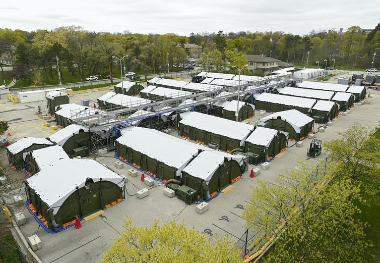 Exterior shot of temporary buildings in a parking lot.