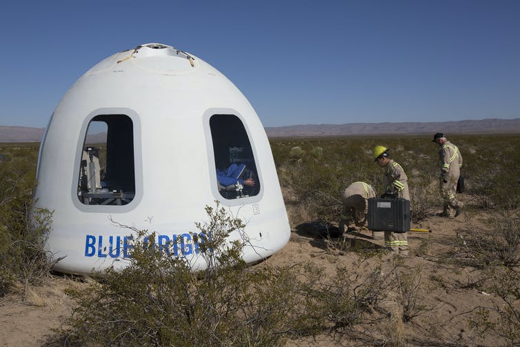 A white domed capsule with windows in the Texas desert.
