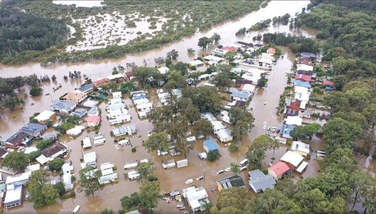 aerial view of flooded caravans, cabins and houses
