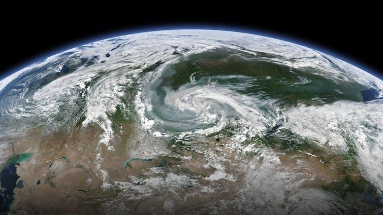 Obraz satelitarny Ziemi z wirującymi pożarami